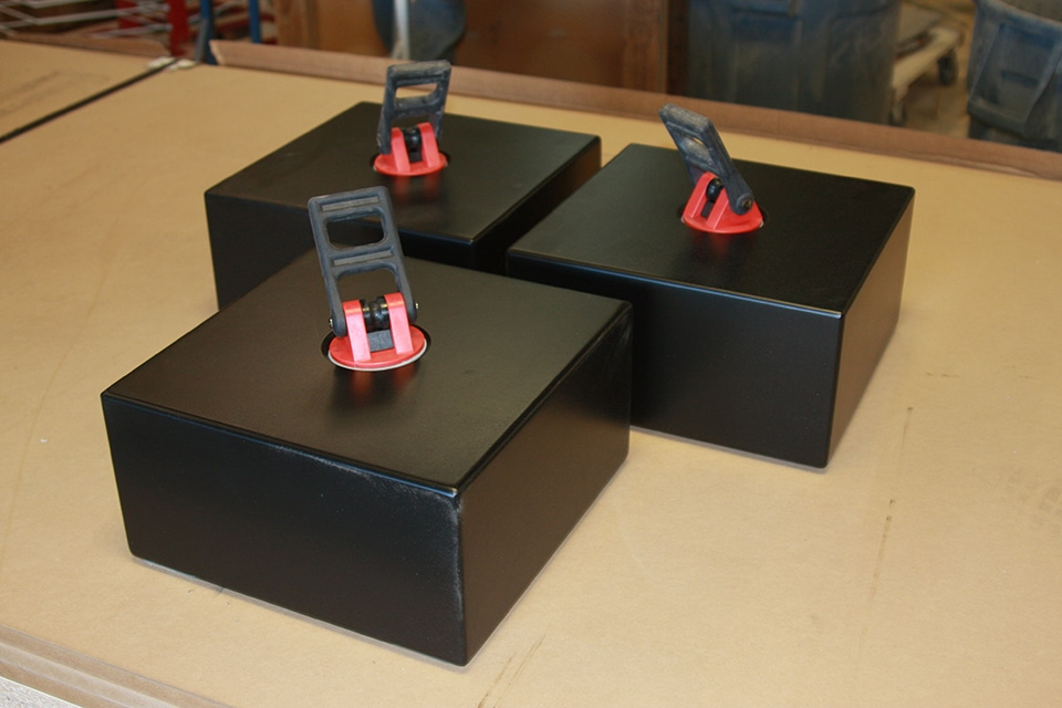 image of three black camera isolation stands