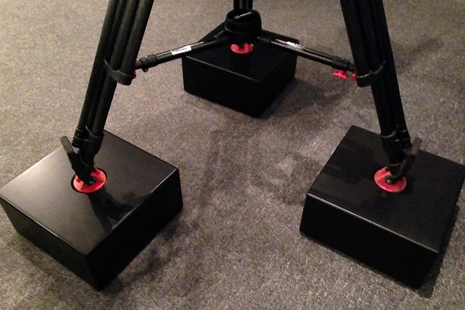 image of three mounted black camera isolation stands