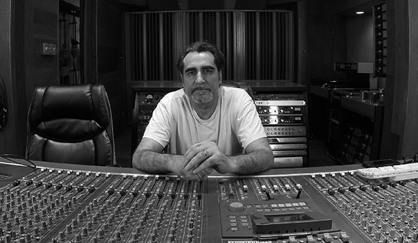photo of Sam Boumoujahed sitting on mixing console